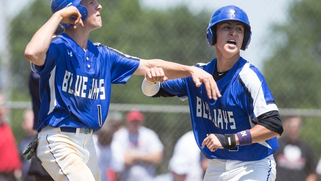 Middlesex's Mike Schweyher and Jared Venutolo celebrate a run early in the game Middlesex defeats Emerson in NJSIAA Group I championship game played at Toms River High School North. 