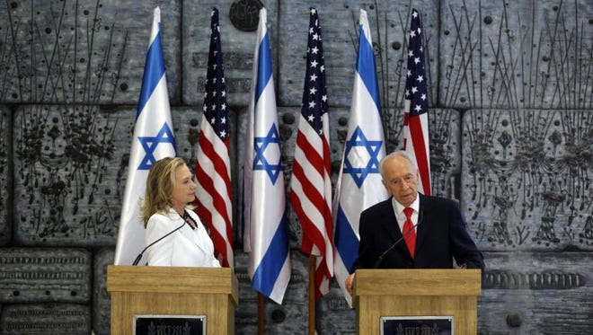 Secretary of State Hillary Clinton and Israeli President Shimon Peres in Jerusalem in 2012.