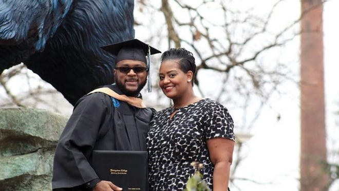 Troy Savage, a graduate of Nandua High School, stands with his wife, April, after his graduation from Livingstone College on Dec. 16, 2016.
