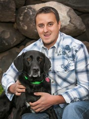 Jake Guell, certified dog trainer and owner of Tails