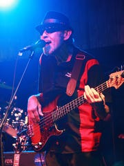 Bass player Greg Lintemuth plays as a part of Billy Mack and The Juke Joint Johnnies at Backroads Saloon in Marshall Friday evening.