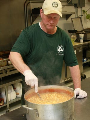 Jeff Rzepka is cooking chicken chili at Pastrami Joe's in preparation for Saturday's charity cook-off for The Haven of Rest Ministries.