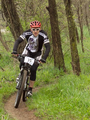 Josh Verhage races through the trees during the expert competition for the Stampede at Fort Custer.