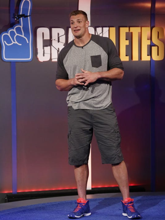 "In this March, 2016 photo provided by Nickelodeon, Rob Gronkowski hosts ""Crashletes,"" in Los Angeles, debuting July 5, 2016 on Nickelodeon. The New England Patriots tight end will be the face of the show introducing popular viral videos of sports bloopers. (Nickelodeon via AP)"