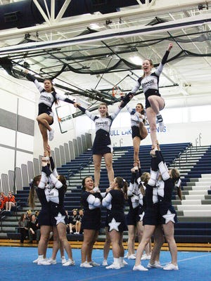 Gull Lake's varsity cheer team performs during the Blue Devil Invitational at Gull Lake High School on Saturday.