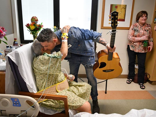 Michael Ray hugs Mary Haupt as he arrives to do a personal performance in her room. Ray helped Musicians on Call launch a new ongoing Beside Performance Program at Sunrise Hospital and Medical Center in Las Vegas, where many of the Route 91 Harvest music festival shooting victims were treated.