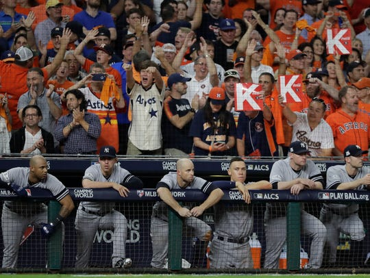 The New York Yankees dugout watches during the ninth
