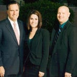 Anissa Ford, center, is shown posing next to Mitt Romney.