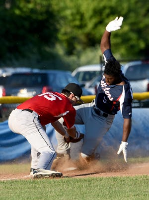 Carl Turner slides safely into third for the Licking County Settlers during a game earlier this summer.