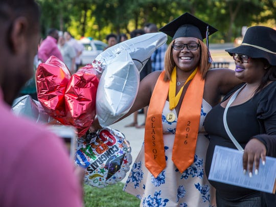 Chyna Johnson poses with Quanii Williams, her best friend, outside Broad Ripple High School after graduating with honors.