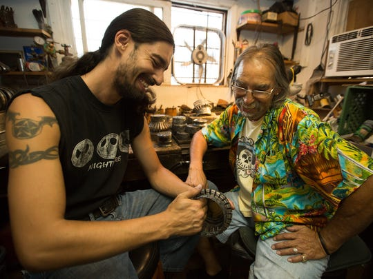 Artist Peter Van Tongeren, right, works with his son Zach Van Tongeren at their Las Cruces studio. Peter is serious about regular checkups for himself and his relatives after his prostate cancer diagnosis and several cancer deaths in his family.