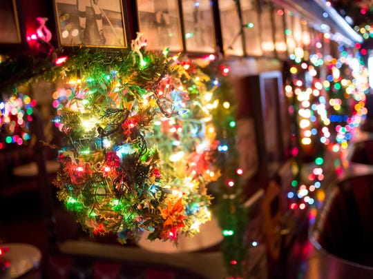 Christmas decorations cover every wall Friday, Nov. 18, 2016 at The Brass Rail in downtown Port Huron.