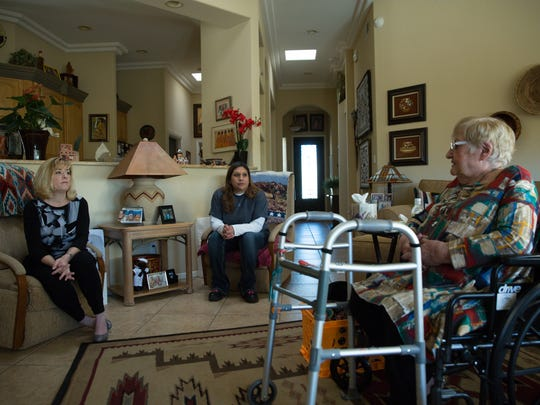 Buffy Johnson,left, Bridget Chavarria and Frances Williams sit and chat in  Williams home, Friday February 10, 2017. Williams is a client of Johnson's who hired Bridget Chavarria as a care giver  for Williams.