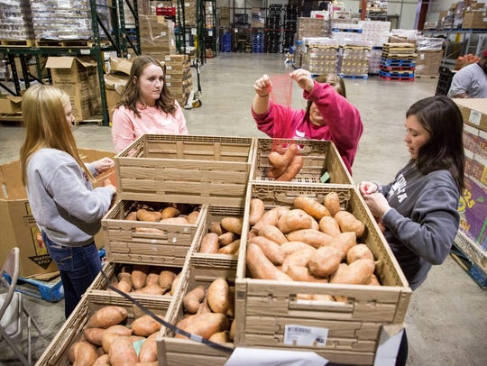 Volunteers from Ball State University helps sort through