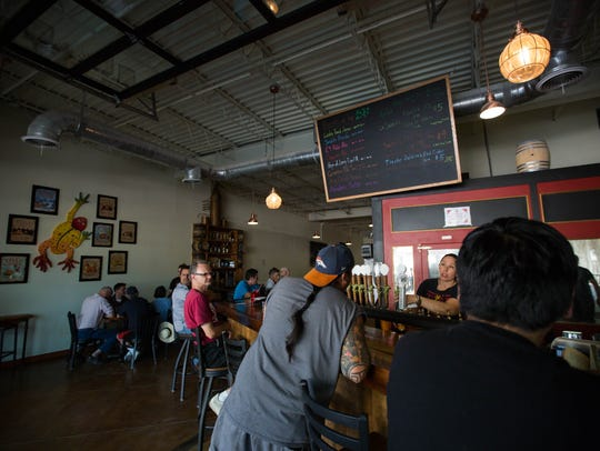 Customers at Las Cruces Little Toad Creek Brewery and Distillery, which opened Downtown in early May.
