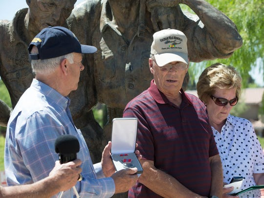 Hurbert Gay, center, stands with his family in front of the Bataan Death March Memorial at Veterans Memorial Park, and is about to receive from U.S. Rep. Steve Pearce, R.-N.M., a posthumously awarded Bronze Star, European -African-Middle Eastern Campaign Medal and Combat Infantryman Badge for his father, George H. Gay. Friday May 25, 2018