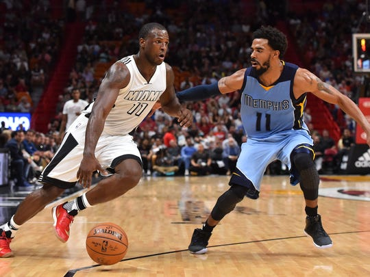 Miami Heat guard Dion Waiters (11) drives the ball around Memphis Grizzlies guard Mike Conley (11) during the second half at American Airlines Arena.