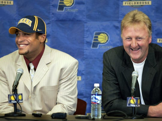 David Harrison, left and Larry Bird, right, laugh at the press conference, June 28, 2004.