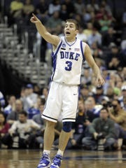 Duke's Greg Paulus gestures during first half action