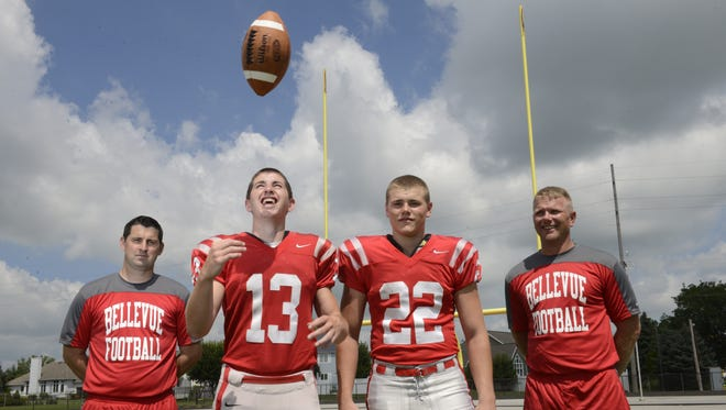Left to right, Bellevue quarterback coach JJ Foos, quarterback Al Foos, running back Bryce Ray and defensive assistant coach Jeff Ray look to help Bellevue back to the playoffs.