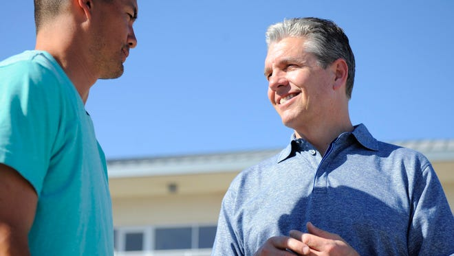 Sports agent Casey Close, right, talks with client Jeremy Guthrie during a Royals spring training game against the Chicago Cubs at Surprise Stadium.