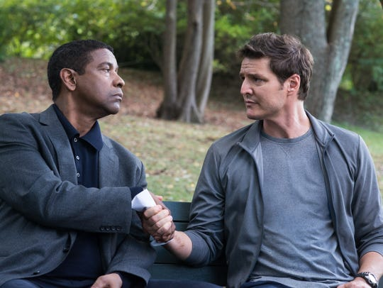 "Denzel Washington (left) and Pedro Pascal star in ""The"