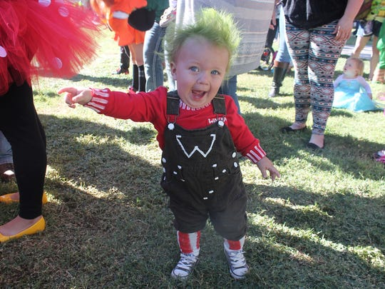 Michael Hamm, 1, is dressed as an umpa lumpa from Willy Wonka and the Chocolate Factory during Zoo Boo 2015.