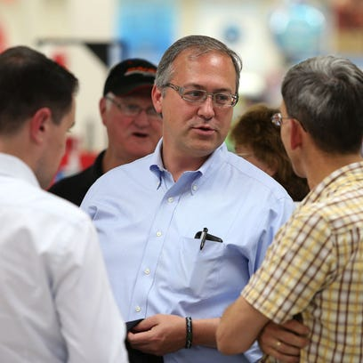 Republican congressional candidate David Young visits with supporters on Tuesday, Sept. 30, 2014, at Hy-Vee in Creston.