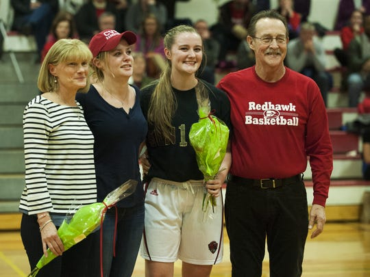 "CVU's Emma Hess poses for a photo with family, including father Richard ""Dick"" Hess, as the seniors are honored before the start of the girls basketball game between Spaulding and Champlain Valley Union at CVU high school on Thursday night February 11, 2016 in Hinesburg."