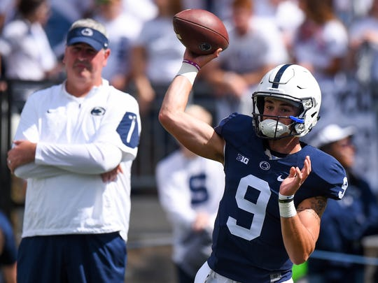 Penn State Nittany Lions quarterback Trace McSorley (9) warms up as offensive coordinator Joe Moorhead looks on prior to the game against the Pittsburgh Panthers at Beaver Stadium. Mandatory Credit: Rich Barnes-USA TODAY Sports