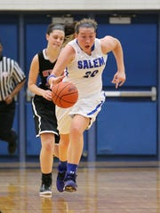 Pushing the ball up the floor Friday night is Salem senior Hayley Rogers.
