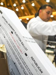 Primary Election ballots are aligned in a paper jogger