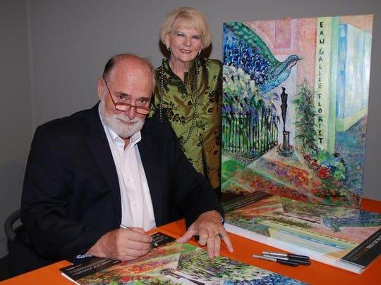 Featured artist Frits van Eeden poses with Darcia Jones