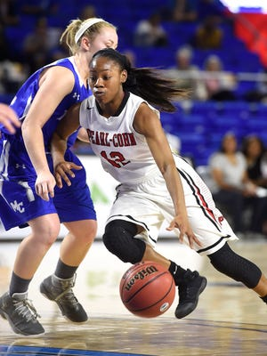 Shawnta Shaw (12) drives as Pearl-Cohn plays Macon County in the Class AA girls basketball state quarterfinals Thursday, March 9, 2017.