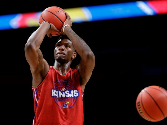 Kansas forward Silvio De Sousa shoots during a practice session for the Final Four NCAA college basketball tournament, Friday, March 30, 2018, in San Antonio. (AP Photo/David J. Phillip)