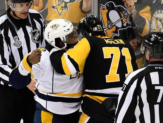 Predators defenseman P.K. Subban fights with Penguins