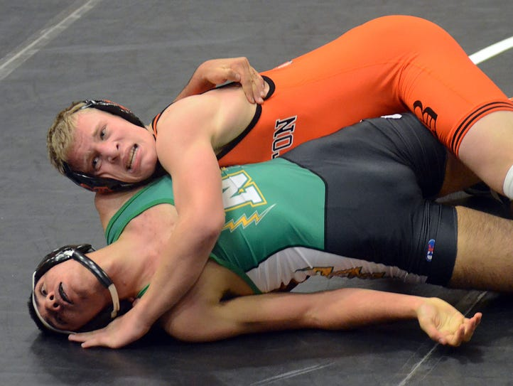 Greyson Stevens (top) was one of four Brighton wrestlers