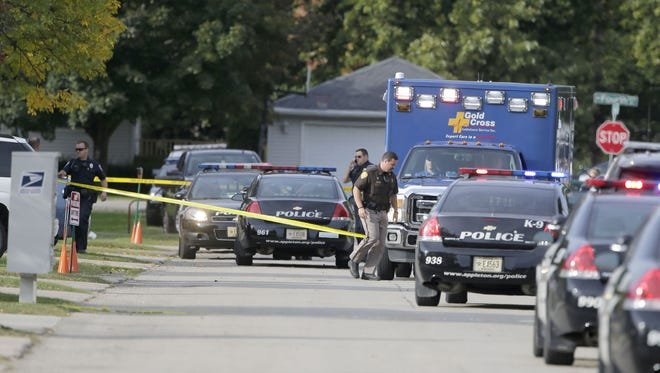 Law enforcement and emergency responders gather near the scene of a shooting in the 600 block of Olson Ave., Sunday, September 17, 2017, in Appleton, Wis.