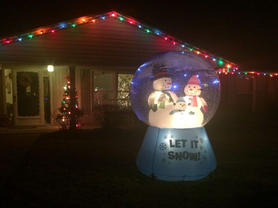 Neighbors surprised the family of Autumn Placek by displaying holiday decorations and lights, including an inflatable snow globe, outside their De Pere home after the death of Placek's husband Dec. 2.