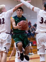 Mt. Whitney's Bo Larsen, left and Anthony Valencia defend against El Diamante's Jake Gonzalez in a West Yosemite League high school boys basketball game on Wednesday, January 3, 2018.
