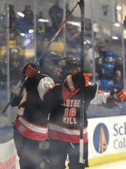 Alex Andoni is congratul;ated byBrother Rice teammate
