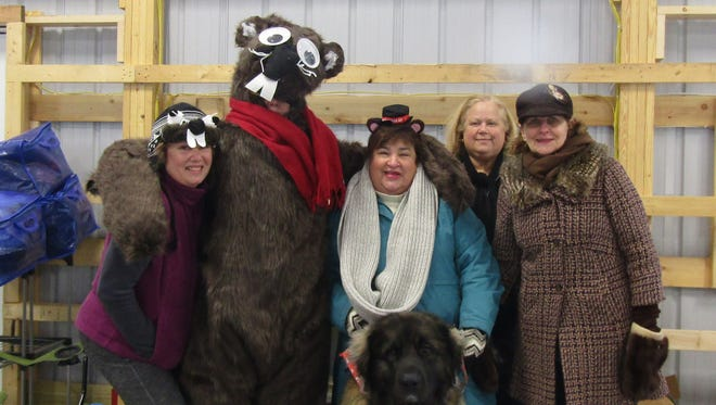 Among the Team Groundhog volunteers who worked on the Ellison Bay Groundhog Day Parade are, from left, Kathleen Fernandez, Cheryl Culver, Tina Gan, Ann Silberman and Susan Larson, joined by Hobbs the dog.