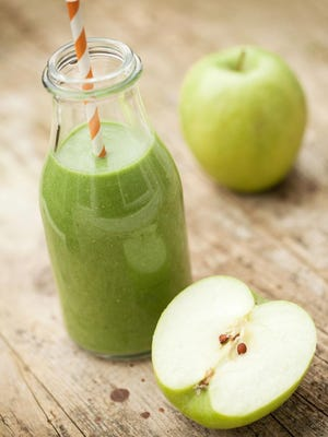 Green apple and other sweet ingredients hide the bitter taste of kale in a green smoothie.