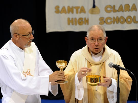 Archbishop Jose Gomez, right, will celebrate a special Memorial Day Mass in Oxnard on Monday.