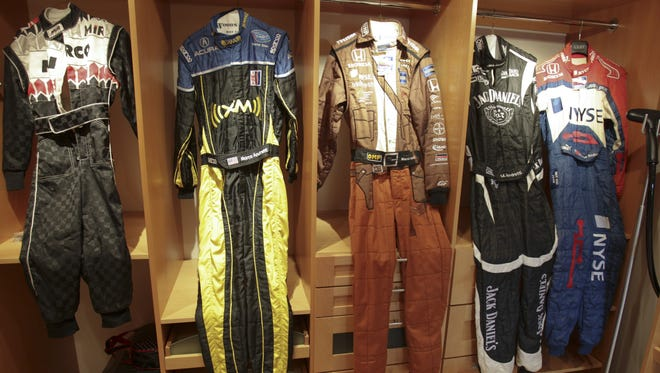 Marco Andretti showcases the Indiana Jones uniform he wore in the 2008 Indianapolis 500 at his home in Nazareth, Pa.