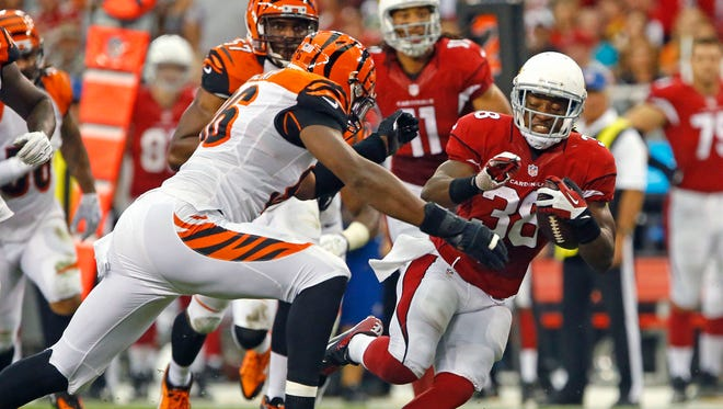 Arizona Cardinals running back Andre Ellington (38) runs against the Cincinnati Bengals during the second quarter of their NFL pre-season game Sunday, Aug. 24,  2014 in Glendale.