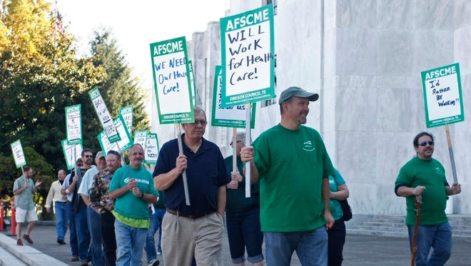 Members of Oregon AFSCME Local 3932 hold a demonstration on the Oregon Capitol steps in 2013.