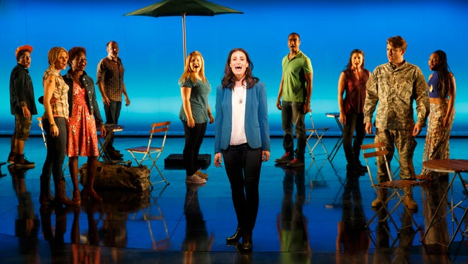 Idina Menzel and cast members in a scene from the new Broadway musical, 'If/Then.'