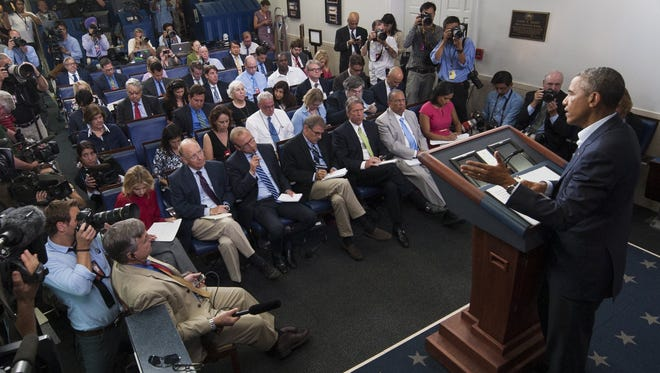 President Obama and reporters at the White House.