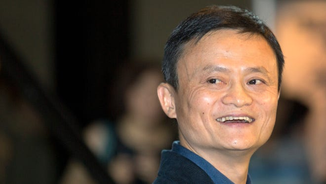 Alibaba founder and Executive Chairman Jack Ma smiles before his IPO roadshow at a hotel in Hong Kong on Sept. 15.